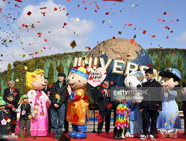 Charlie Broan in Chinese Snoopy in Japanese Sally in Korean and Lucy in Vietnamese national costumes greet Asian countries guests and students of an...