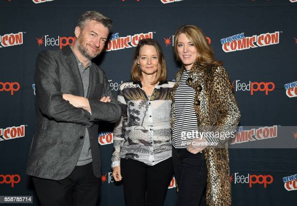 Charlie Brooker director Jodie Foster and Annabel Jones pose backstage before they discuss Netflix' Black Mirror during New York Comic Con 2017 at...
