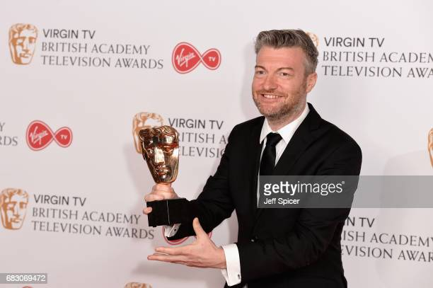 Charlie Brooker poses with the award for Comedy Entertainment Programme in the Winner's room at the Virgin TV BAFTA Television Awards at The Royal...