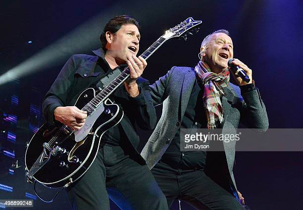 Charlie Burchill and Jim Kerr of Simple Minds perform live on stage at The O2 Arena on November 26 2015 in London England
