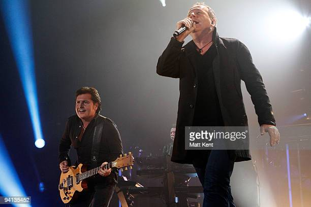 Charlie Burchill and Jim Kerr of Simple Minds perform on stage at Wembley Arena on December 7 2009 in London England