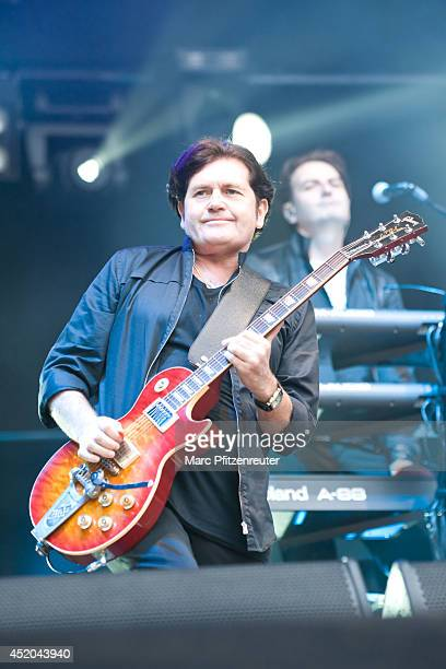 Charlie Burchill guitarist of scottish rock band Simple Minds performs live during their 'Best Of Tour 2014' at the KunstRasen on July 11 2014 in...