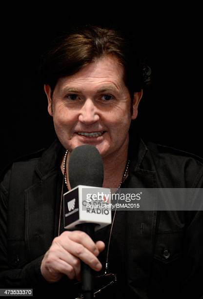 Charlie Burchill of Simple Minds at Radio Row during the 2015 Billboard Music Awards at MGM Grand Garden Arena on May 15 2015 in Las Vegas Nevada