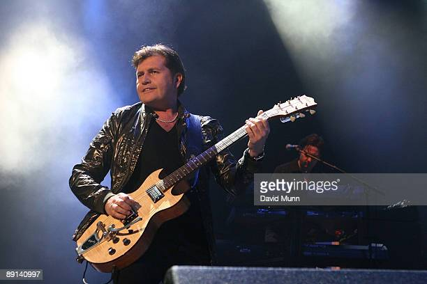 Charlie Burchill of Simple Minds performs at Liverpool Echo Arena on July 21 2009 in Liverpool England