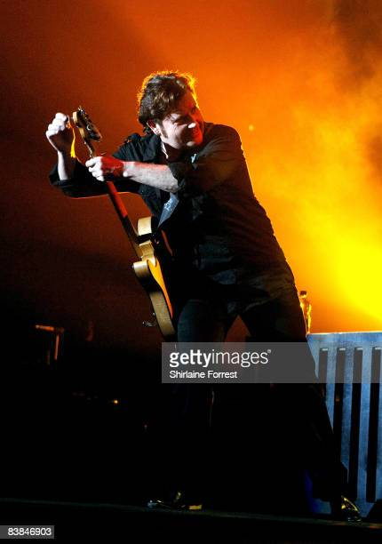 Charlie Burchill of Simple Minds performs on stage at the Manchester Evening News Arena on November 27 2008 in Manchester England