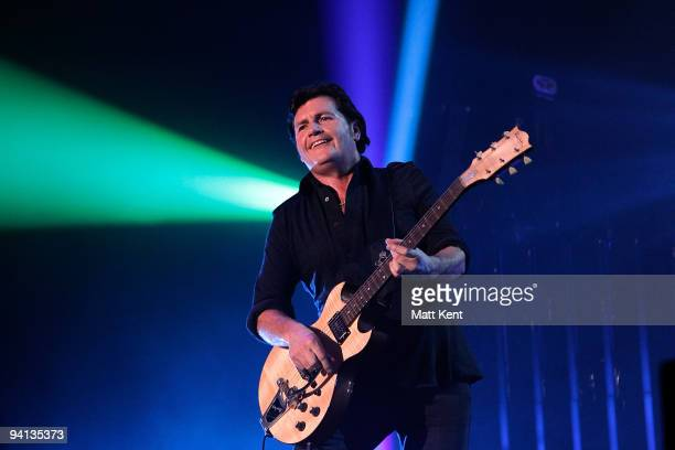 Charlie Burchill of Simple Minds performs on stage at Wembley Arena on December 7 2009 in London England