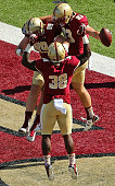 Charlie Callinan of the Boston College Eagles celebrates wiht Richard Wilson and Tommy Sweeney after scoring a touchdown against the Northern...