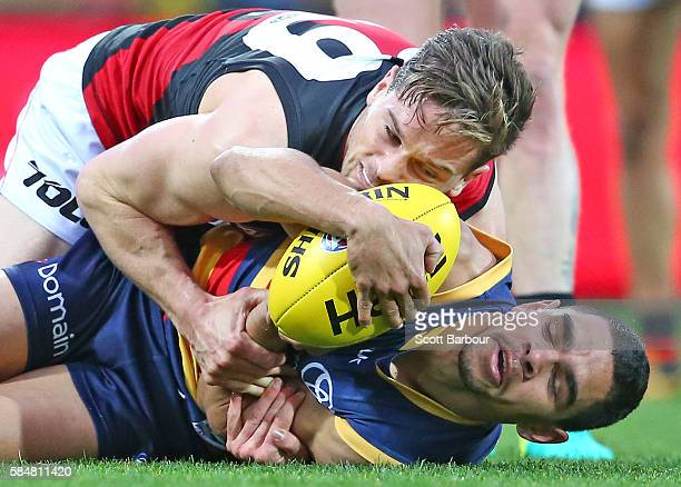 Charlie Cameron of the Crows and Patrick Ambrose of the Bombers compete for the ball during the round 19 AFL match between the Adelaide Crows and the...