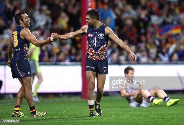 Charlie Cameron of the Crows celebrates a goal with Eddie Betts of the Crows during the round 10 AFL match between the Adelaide Crows and the...
