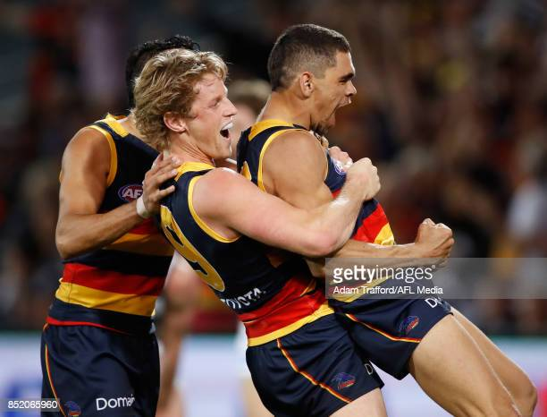Charlie Cameron of the Crows celebrates a goal with Rory Sloane and Eddie Betts of the Crows during the 2017 AFL First Preliminary Final match...