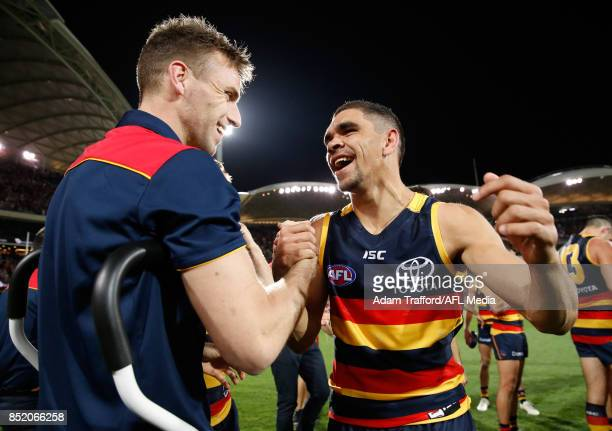 Charlie Cameron of the Crows consoles an injured Brodie Smith of the Crows who will miss the grand final during the 2017 AFL First Preliminary Final...