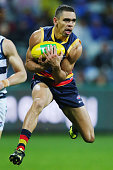 Charlie Cameron of the Crows marks the ball during the round 18 AFL match between the Geelong Cats and the Adelaide Crows at Simonds Stadium on July...