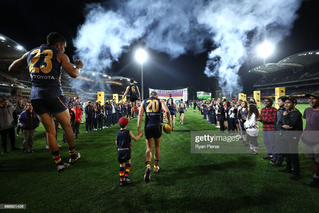 Charlie Cameron of the Crows runs out onto the ground during the round 10 AFL match between the Adelaide Crows and the Fremantle Dockers at Adelaide Oval on May 27, 2017 in Adelaide, Australia.