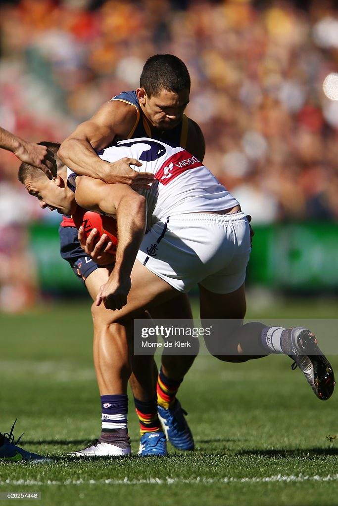 Charlie Cameron of the Crows tackles Stephen Hill of the Dockers during the round six AFL match between the Adelaide Crows and the Fremantle Dockers at Adelaide Oval on April 30, 2016 in Adelaide, Australia.