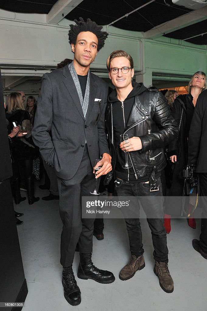Charlie Casely-Hayford and Oliver Proudlock attend the launch of Dinos Chapman's album 'Luftbobler' at The Vinyl Factory Gallery on February 27, 2013 in London, England.