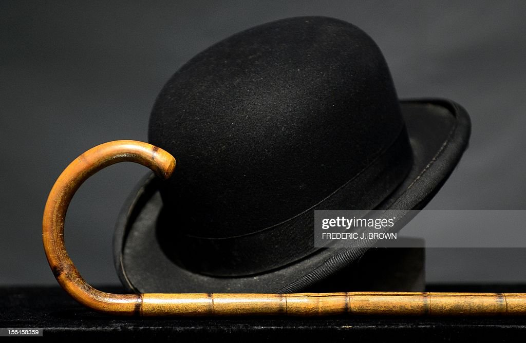 Charlie Chaplain's iconic bowler hat and cane are displayed during a press preview at auction house Bonham's in Hollywood, California, on November 15, 2012. Chaplin's hat and cane are to go under the hammer in Los Angeles this weekend as part of an auction which also includes a John Lennon nude drawing of himself and Yoko Ono. The hat and cane trademark of Chaplin's Little Tramp character are in 'remarkable condition' and are estimated to go for between $40,000 and $60,000 at the sale by auction house Bonhams on Sunday November 18. AFP PHOTO / Frederic J. BROWN
