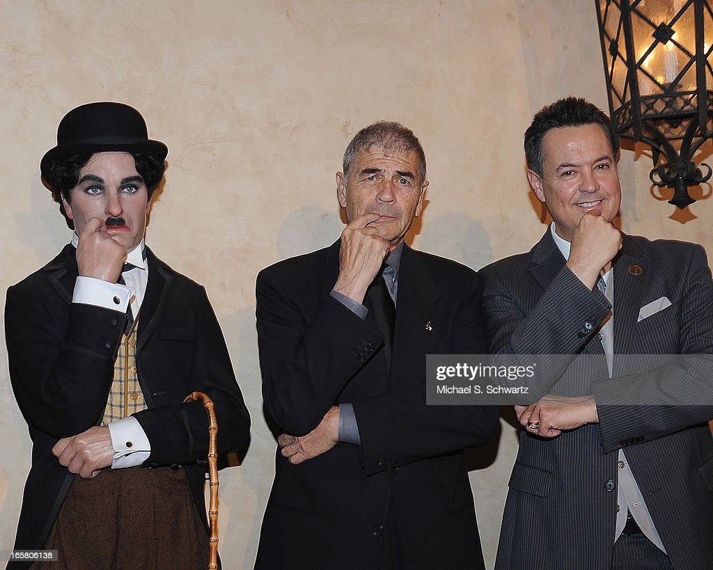Charlie Chaplan figure, actor Robert Forster and ABC Entertainment Correspondant George Pennacchio attend the Hollywood Arts Council's 27th Annual Charlie Awards Luncheon at the Hollywood Roosevelt Hotel on April 5, 2013 in Hollywood, California.