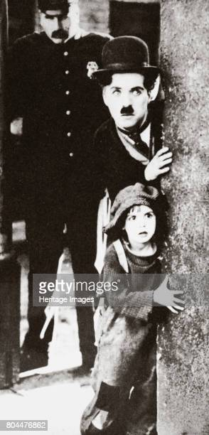 Charlie Chaplin and Jackie Coogan in 'The Kid' 1921 British comedian actor and film star Charlie Chaplin and American actor John Leslie Coogan who...