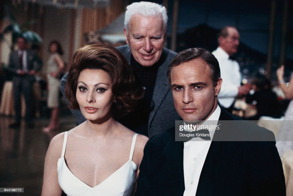 Charlie Chaplin (C) directs Sophia Loren and Marlon Brando on the set of his last movie A Countess from Hong Kong. Movied released: 1967.