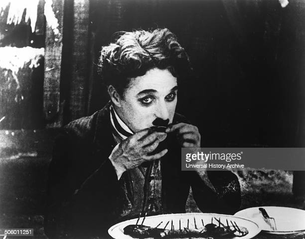Charlie Chaplin KBE The Tramp resorts to eating his boot in a famous scene from The Gold Rush