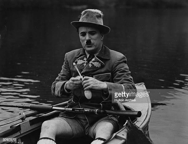 Charlie Chaplin sits in a boat in a scene from the United Artists film 'The Great Dictator' directed by Chaplin himself