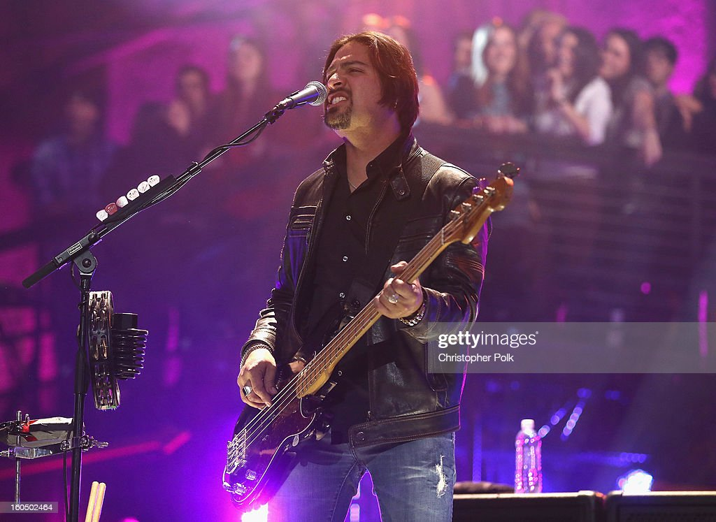<a gi-track='captionPersonalityLinkClicked' href=/galleries/search?phrase=Charlie+Colin&family=editorial&specificpeople=2997546 ng-click='$event.stopPropagation()'>Charlie Colin</a> of Train performs during the VH1 Best Super Bowl Concert Ever at Sugar Mill on February 1, 2013 in New Orleans, Louisiana.