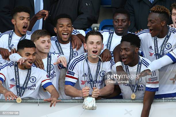 Charlie Colkett of Chelsea FC lifts the UEFA Youth League trophy in celebration after victoy in the UEFA Youth League Final match between Paris Saint...