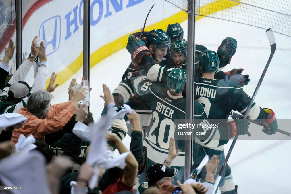 <a gi-track='captionPersonalityLinkClicked' href=/galleries/search?phrase=Charlie+Coyle&family=editorial&specificpeople=7029381 ng-click='$event.stopPropagation()'>Charlie Coyle</a> #3, <a gi-track='captionPersonalityLinkClicked' href=/galleries/search?phrase=Jason+Pominville&family=editorial&specificpeople=570525 ng-click='$event.stopPropagation()'>Jason Pominville</a> #29, <a gi-track='captionPersonalityLinkClicked' href=/galleries/search?phrase=Zach+Parise&family=editorial&specificpeople=213606 ng-click='$event.stopPropagation()'>Zach Parise</a> #11, <a gi-track='captionPersonalityLinkClicked' href=/galleries/search?phrase=Ryan+Suter&family=editorial&specificpeople=583306 ng-click='$event.stopPropagation()'>Ryan Suter</a> #20 and <a gi-track='captionPersonalityLinkClicked' href=/galleries/search?phrase=Mikko+Koivu&family=editorial&specificpeople=584987 ng-click='$event.stopPropagation()'>Mikko Koivu</a> #9 of the Minnesota Wild celebrate a goal against the Colorado Avalanche by Coyle during the second period in Game Four of the First Round of the 2014 NHL Stanley Cup Playoffs on April 24, 2014 at Xcel Energy Center in St Paul, Minnesota.
