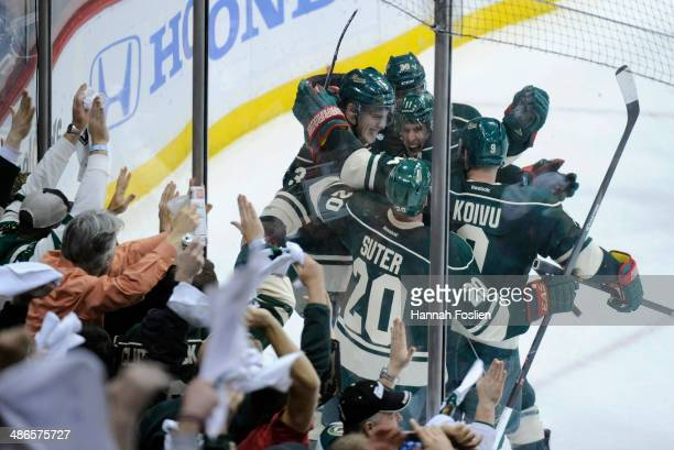 Charlie Coyle Jason Pominville Zach Parise Ryan Suter and Mikko Koivu of the Minnesota Wild celebrate a goal against the Colorado Avalanche by Coyle...