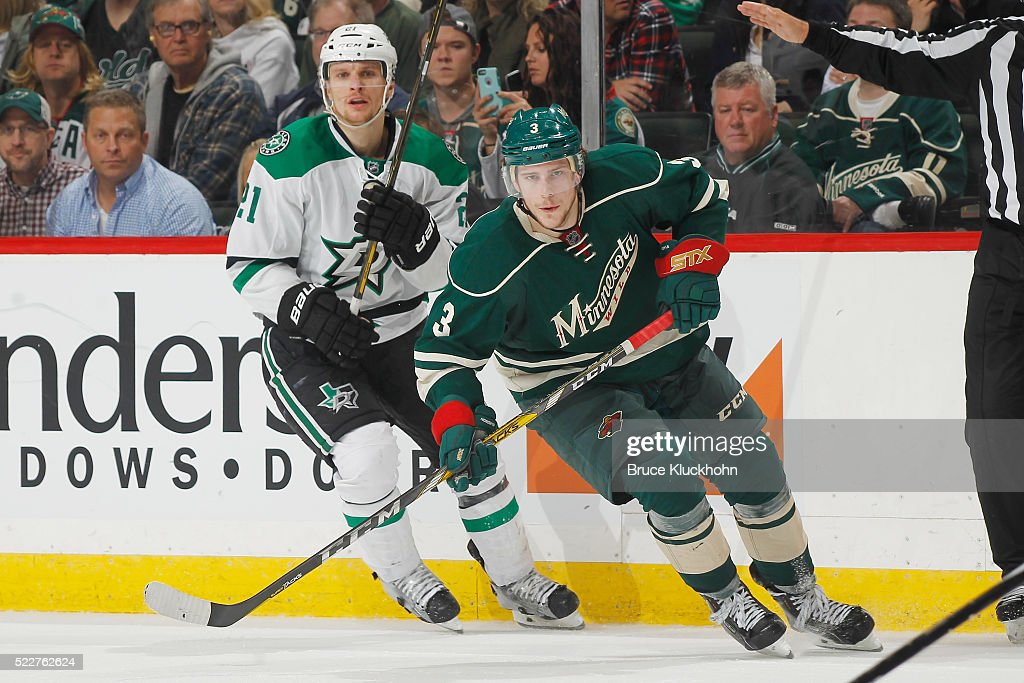 Charlie Coyle #3 of the Minnesota Wild and Antoine Roussel #21 of the Dallas Stars skate to the puck in Game Four of the Western Conference First Round during the 2016 NHL Stanley Cup Playoffs on April 20, 2016 at the Xcel Energy Center in St. Paul, Minnesota.
