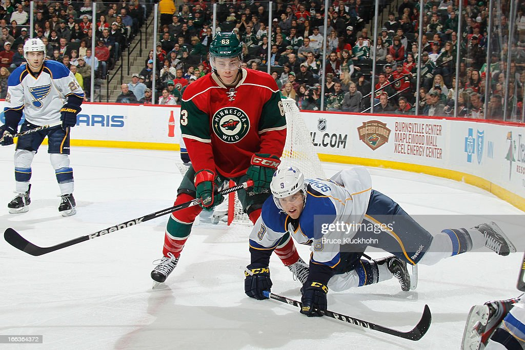 Charlie Coyle #63 of the Minnesota Wild and Jaden Schwartz #9 of the St. Louis Blues battle for position during the game on April 11, 2013 at the Xcel Energy Center in Saint Paul, Minnesota.