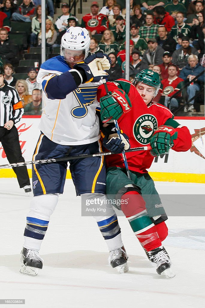 Charlie Coyle #63 of the Minnesota Wild and <a gi-track='captionPersonalityLinkClicked' href=/galleries/search?phrase=Jordan+Leopold&family=editorial&specificpeople=201885 ng-click='$event.stopPropagation()'>Jordan Leopold</a> #33 of the St. Louis Blues battle for position during the game on April 1, 2013 at the Xcel Energy Center in Saint Paul, Minnesota.