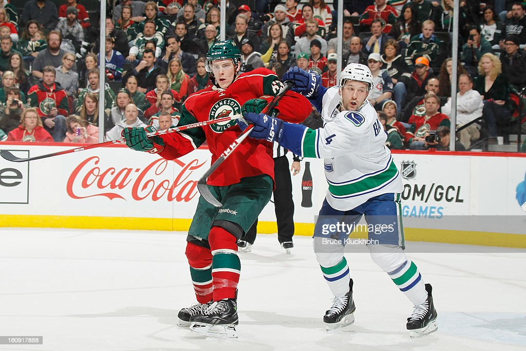 Charlie Coyle #63 of the Minnesota Wild and <a gi-track='captionPersonalityLinkClicked' href=/galleries/search?phrase=Keith+Ballard+-+Ice+Hockey+Player&family=editorial&specificpeople=630546 ng-click='$event.stopPropagation()'>Keith Ballard</a> #4 of the Vancouver Canucks battle for position during the game on February 7, 2013 at the Xcel Energy Center in Saint Paul, Minnesota.