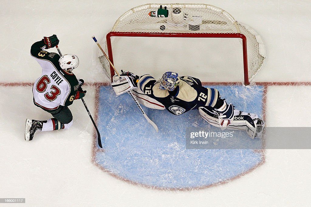 Charlie Coyle #63 of the Minnesota Wild beats <a gi-track='captionPersonalityLinkClicked' href=/galleries/search?phrase=Sergei+Bobrovsky&family=editorial&specificpeople=4488556 ng-click='$event.stopPropagation()'>Sergei Bobrovsky</a> #72 of the Columbus Blue Jackets for a goal during the second period on April 7, 2013 at Nationwide Arena in Columbus, Ohio. Minnesota defeated Columbus 3-0.