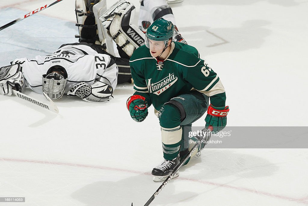 Charlie Coyle #63 of the Minnesota Wild celebrates after scoring a goal against goalie <a gi-track='captionPersonalityLinkClicked' href=/galleries/search?phrase=Jonathan+Quick&family=editorial&specificpeople=2271852 ng-click='$event.stopPropagation()'>Jonathan Quick</a> #32 of the Los Angeles Kings during the game on March 30, 2013 at the Xcel Energy Center in Saint Paul, Minnesota.
