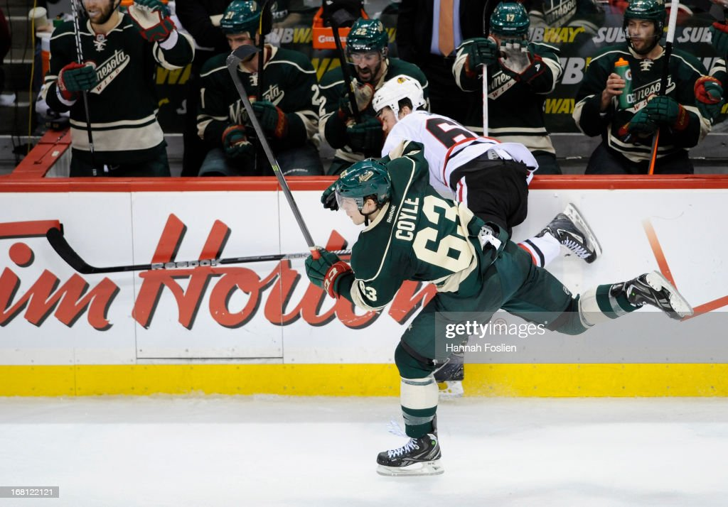 <a gi-track='captionPersonalityLinkClicked' href=/galleries/search?phrase=Charlie+Coyle&family=editorial&specificpeople=7029381 ng-click='$event.stopPropagation()'>Charlie Coyle</a> #63 of the Minnesota Wild checks Andrew Shaw #65 of the Chicago Blackhawks into the boards during the third period of Game Three of the Western Conference Quarterfinals during the 2013 NHL Stanley Cup Playoffs at Xcel Energy Center on May 5, 2013 in St Paul, Minnesota. The Wild defeated the Blackhawks 3-2 in overtime.