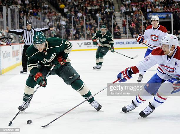 Charlie Coyle of the Minnesota Wild controls the puck against Andrei Markov of the Montreal Canadiens during the first period of the game on November...