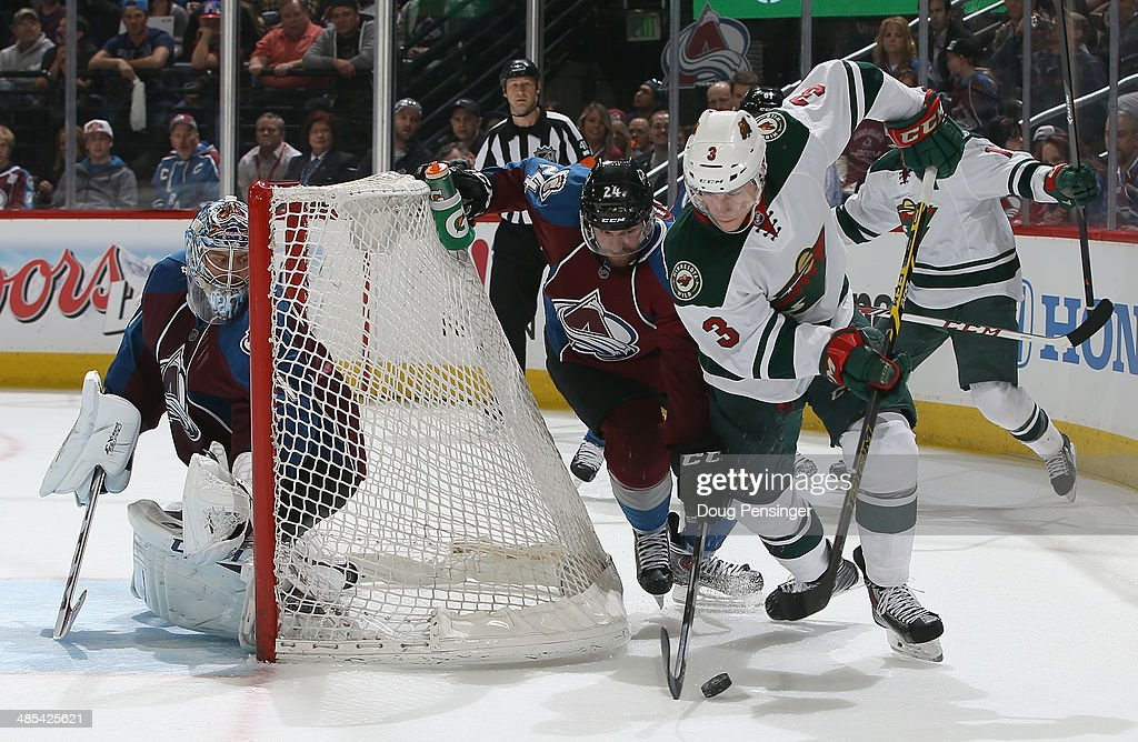 <a gi-track='captionPersonalityLinkClicked' href=/galleries/search?phrase=Charlie+Coyle&family=editorial&specificpeople=7029381 ng-click='$event.stopPropagation()'>Charlie Coyle</a> #3 of the Minnesota Wild controls the puck against the defense of Marc-Andre Cliche #24 of the Colorado Avalanche as goalie <a gi-track='captionPersonalityLinkClicked' href=/galleries/search?phrase=Semyon+Varlamov&family=editorial&specificpeople=6264893 ng-click='$event.stopPropagation()'>Semyon Varlamov</a> #1 of the Colorado Avalanche defends the goal in Game One of the First Round of the 2014 NHL Stanley Cup Playoffs at Pepsi Center on April 17, 2014 in Denver, Colorado. The Avalanche defeated the Wild 5-4 in overtime to take a 1-0 game advantage in the series.