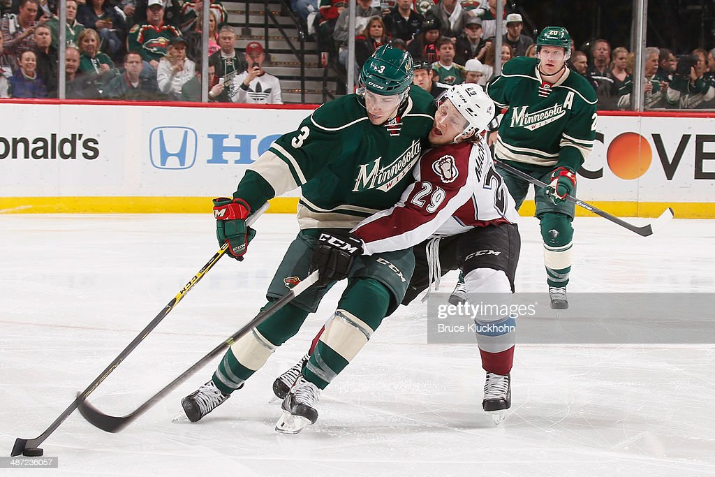 Charlie Coyle #3 of the Minnesota Wild controls the puck with Nathan MacKinnon #29 of the Colorado Avalanche closely defending during Game Six of the First Round of the 2014 Stanley Cup Playoffs on April 28, 2014 at the Xcel Energy Center in St. Paul, Minnesota.