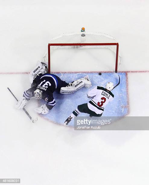 Charlie Coyle of the Minnesota Wild dekes out goaltender Ondrej Pavelec of the Winnipeg Jets and slides the puck into the net to clinch the 32...