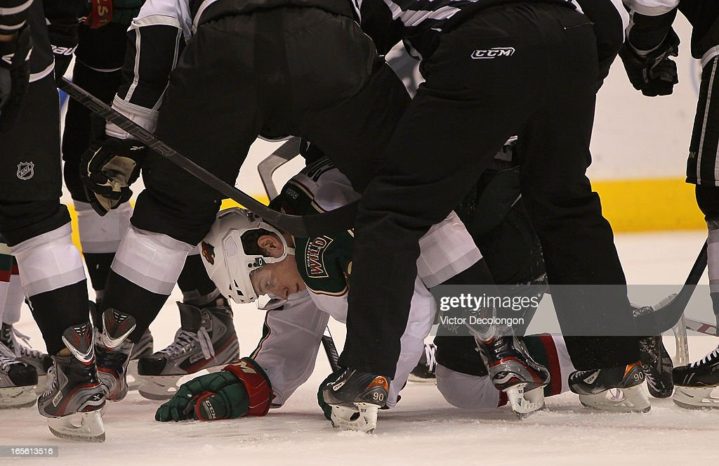 Charlie Coyle #63 of the Minnesota Wild finds himself on the ice after the whistle during the NHL game against the Los Angeles Kings at Staples Center on April 4, 2013 in Los Angeles, California. The Kings defeated the Wild 3-0.