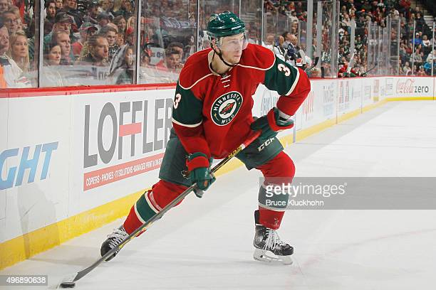 Charlie Coyle of the Minnesota Wild handles the puck against the Tampa Bay Lightning during the game on November 7 2015 at the Xcel Energy Center in...