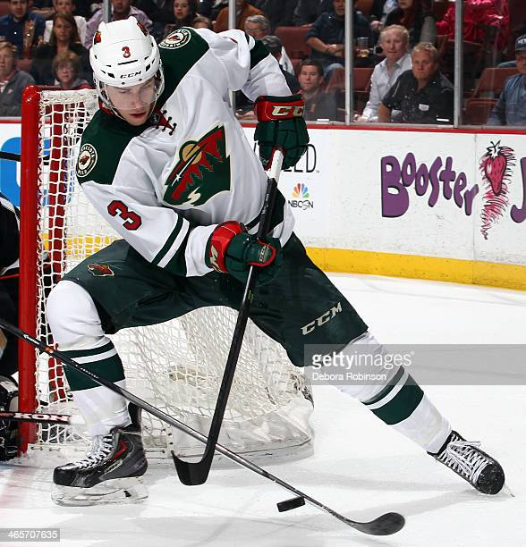 Charlie Coyle of the Minnesota Wild handles the puck during the game against the Anaheim Ducks on January 28 2014 at Honda Center in Anaheim...