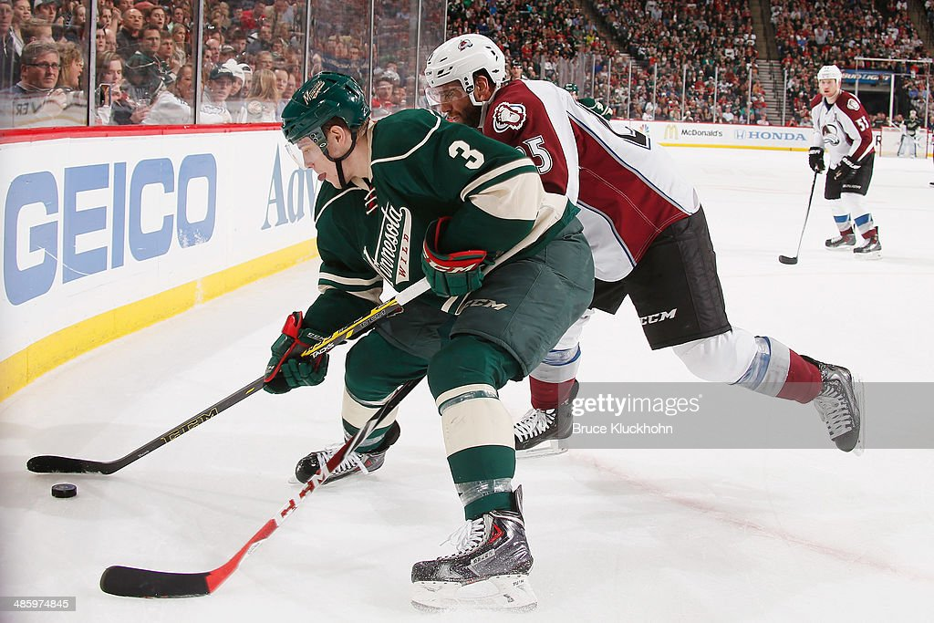 <a gi-track='captionPersonalityLinkClicked' href=/galleries/search?phrase=Charlie+Coyle&family=editorial&specificpeople=7029381 ng-click='$event.stopPropagation()'>Charlie Coyle</a> #3 of the Minnesota Wild handles the puck while <a gi-track='captionPersonalityLinkClicked' href=/galleries/search?phrase=Maxime+Talbot&family=editorial&specificpeople=2078922 ng-click='$event.stopPropagation()'>Maxime Talbot</a> #25 of the Colorado Avalanche defends during Game Three of the First Round of the 2014 Stanley Cup Playoffs on April 21, 2014 at the Xcel Energy Center in St. Paul, Minnesota.