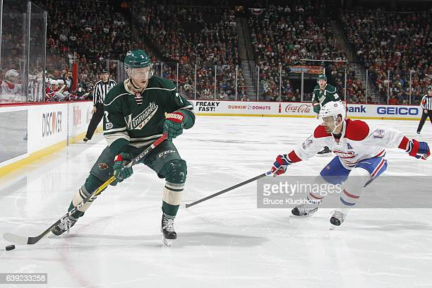 Charlie Coyle of the Minnesota Wild handles the puck with Tomas Plekanec of the Montreal Canadiens defending during the game on January 12 2017 at...