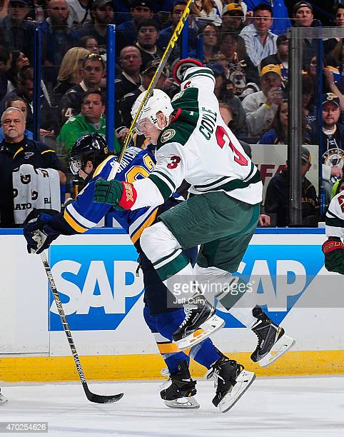 Charlie Coyle of the Minnesota Wild leaps past Kevin Shattenkirk of the St Louis Blues in Game Two of the Western Conference Quarterfinals during the...