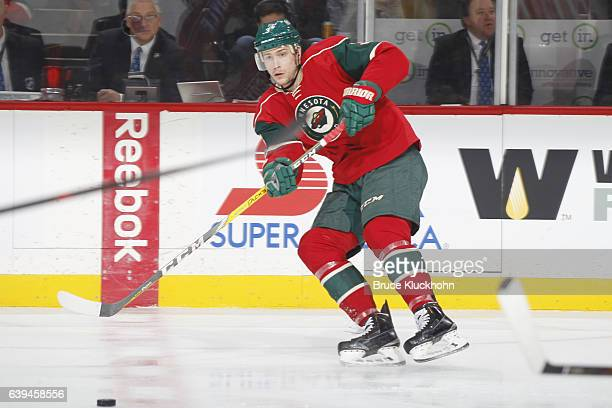 Charlie Coyle of the Minnesota Wild passes the puck against the Arizona Coyotes during the game on January 19 2017 at the Xcel Energy Center in St...