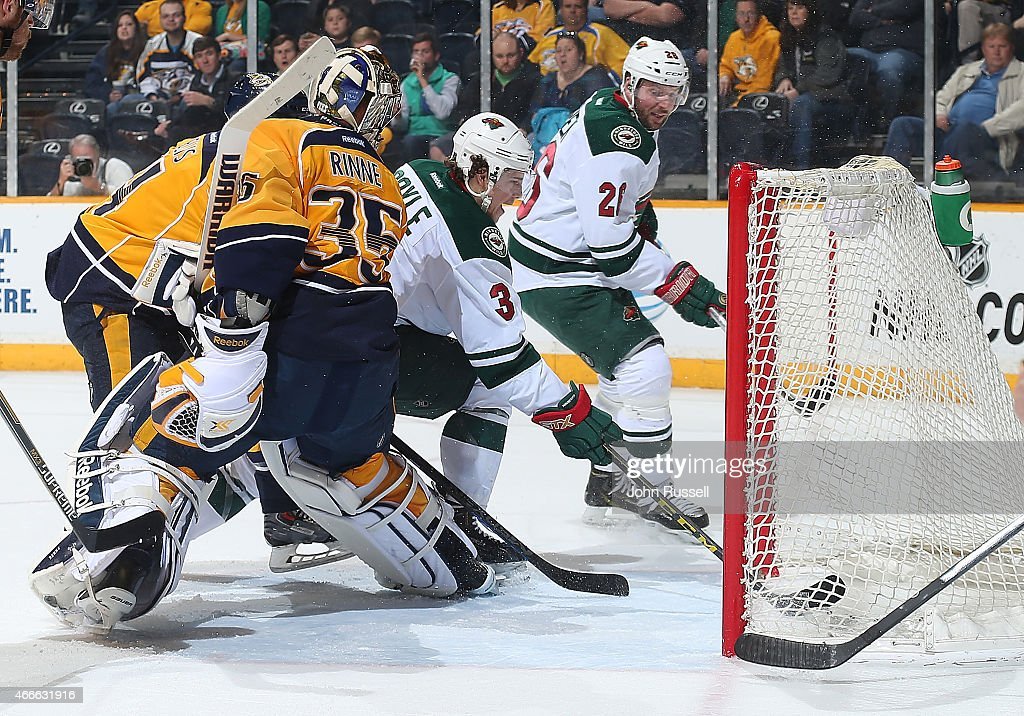 Charlie Coyle of the Minnesota Wild puts the puck in the net against Pekka Rinne of the Nashville Predators during an NHL game at Bridgestone Arena...