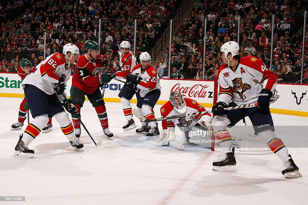 Charlie Coyle #3 of the Minnesota Wild scores a goal against goalie Tim Thomas #34, Tomas Kopecky #82, Erik Gudbranson #44, Mike Mottau #22 and Marcel Goc #57 of the of the Florida Panthers during the game on November 15, 2013 at the Xcel Energy Center in St. Paul, Minnesota.
