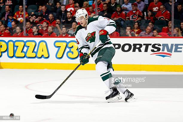 Charlie Coyle of the Minnesota Wild skates against the Calgary Flames at Scotiabank Saddledome on February 18 2015 in Calgary Alberta Canada The Wild...